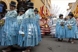 All in turquoise, women from Puno, they later dance along the parade in Lima Independence Day in Peru.