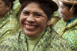 All in green bollera, Puno woman, Lima Independence Day celebrations in Peru.