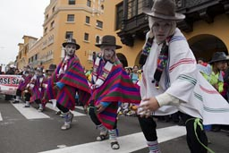 Traditional dances performed by a white masked group, Independence Day in Lima, Peru.