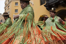 Bollera dresses, green and orange, so beautiful, women from Puno dance and turn on Independence Day, in Lima plaza de armas, Peru.