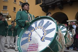 This is loud, makes a big woom, boom, bass drums in a line, Lima Independence Day, Peru.