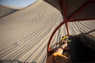 View from sand buggy, down and up a slope, dune in Huacachina.