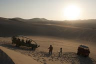 Setting sun, Huacachina, dunes and sand buggies.