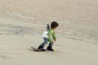Daniel on sand board, dunes of Huacachina.