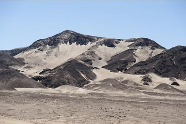 Desert mountain and sand, south from Ica, Peru.