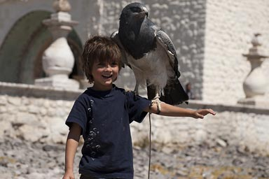 In front of Maca church, David poses with a Condor on sholder, Peru Colca Canyon.
