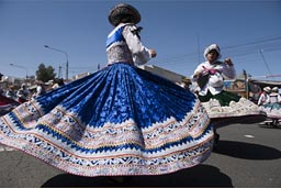 Dresse of folkloric dancers are eleborate bolleras, blue, decorated, Arequipa Day, Peru.