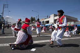 In back Volcan Misti, traditional Andean dances on Arequipa Day parade.