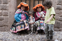 In Cusco, cobble stones and indigenous women in traditional dress, the boys like their lambs and I take a photo for a dollar.