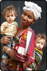 Daniel and David with nanny Aisha, the best we ever had, black African Woman carrying white twin babies, in Bamako, Mali.